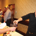 Tim Boynton of Rhode Island Distributing, Co. pouring a sample for Peter Vigeant of Gasbarro's Wines.