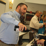 Mike Tobin, Manager, Worldwide Wines pouring samples.