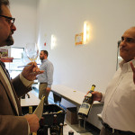Howard Asadow, Worldwide Wines' Regional Manager, with Richard Aries of Charles Fine Wines in Glastonbury, pouring 2014 Hamilton Russell Vineyard Chardonnay of South Africa.