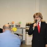 Greg Altieri, Strategic Development Manager, CDI, wearing a Donald Trump wig at the kick off opening.
