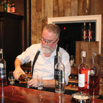 Kent Harrigan, Distiller & Whiskey Maker, Onyx Spirits Company, pouring.