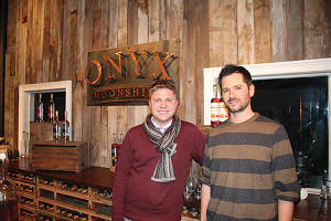 """""""40 Under Forty"""" award recipient, Onyx Spirits Company's Adam von Gootkin with co-owner Pete Kowalczyk, at the 2015 opening of their distillery's tasting room in East Hartford."""