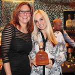 Kelly Scofield, Business Manager, CDI with Amanda Pekar, Patron Portfolio Manager, CDI. Patron Spirits were used in the Mixologist of the Year competition held onsite.