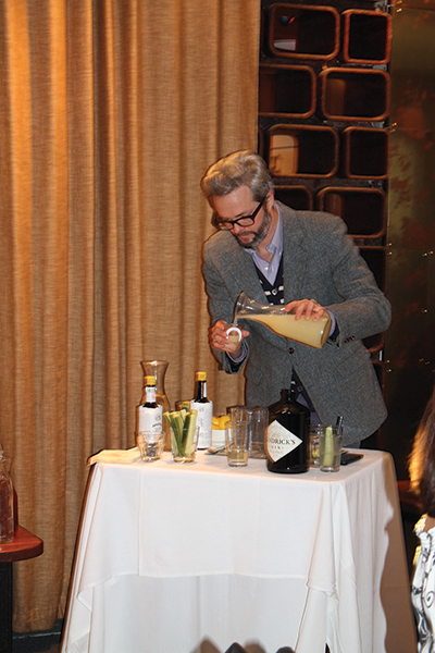Ryan mixing the first Hendrick's Gin cocktail with cucumber and lemonade.