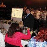 Jamie Montesi, State Manager CT, William Grant & Sons, looking on while guests stir up their cocktails.