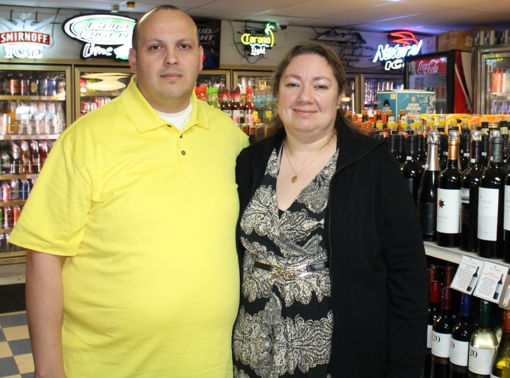Owners Hector and Alicia Lopez of Dexter Warehouse Liquors.