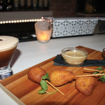 """A cocktail and menu pairing, """"Maple Bourbon Espresso"""" with Kobe beef corn dog bites."""