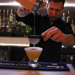 """Rob Martini, Bar Manager, Camps, mixing the """"Angry Canadian Mountie."""""""