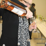 Martine Warner, Worldwide Wines Regional Manager, pouring a rosé.