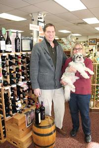 Jim Panzica, Store Manager and Doris Bowlby, Owner with Wine World's Shih Tzu, Buddy.