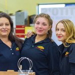 BevMax employees, Claudia Castillo, Laura Garcia and Danica Wilhowy, preparing to welcome guests at the new Danbury store.
