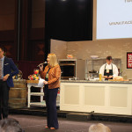 Ryan Kristafer and Laurie Foster served as the event's emcees during the Saturday Grand Tasting. Celebrity Chef William Koval prepares a spiced duck breast during a demonstration.