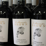 """Z. Alexander Brown Wines at Hartley and Parker Limited. Each bottle is packaged with the word """"uncaged,"""" along with an owl taking flight to show the """"intense, full-bodied expressions"""" of the wine."""