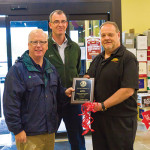 Danbury Mayor Mark D. Boughton (left) presented an award to Michael Berkoff (right), President/CEO of BevMax, LLC, at the Grand Opening celebration. With them is Stephan Rapaglia, Chief Operating Officer and Real Estate Counsel of Urstadt Biddle Properties, Inc. (middle).