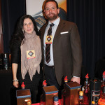 Joe Swanson, Northeast Regional Sales Manager, Classic Imports with Merceles Mendez-Swanson, pouring products from Benromach Distillery for Northeast Beverage Corp.