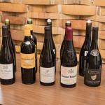 """A lineup of Michael Corso selections. Les Voisins Pinot Noir; Chateau Sainte Eulalie """"Plaisir d' Eulalie;"""" Domaine Chamfort Cote du Rhone; Domaine Raspail-AY Gigondas; Domaine Chevalier, Croze Hermitage Rouge; and Domaine Chevalier, Croze Hermitage Blanc."""