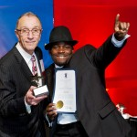 Incoming RIHA Chairman of the Board Angelo DePeri presents Isiah Tsimonjela, line cook at the Hilton Providence, with his Hotel Employee of the Year award.