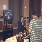 Kenny Ng of Chatham Imports with Michter's Bourbon.