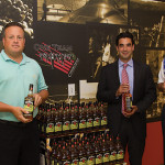 Steve Drew, Business Manager, CDI; Marco Pelliccio, State Manager, Beam Suntory; Steve Baye, Vice President of Business Management and Marketing, CDI with Jim Bean Apple.