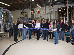 Overshores Brewing Co. founder and president Christian Amport cuts a ceremonial ribbon with East Haven Mayor Joe Maturo and members of the East Haven Chamber of Commerce. Photo by Jennifer Higham Photography, Courtesy East Haven Chamber of Commerce.  (Jennifer Higham Photography)