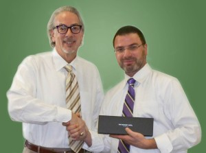 Jerry Rosenberg, President of Hartley and Parker, presents Frank Latorra, Sales Manager, with a watch for his 10 year anniversary.