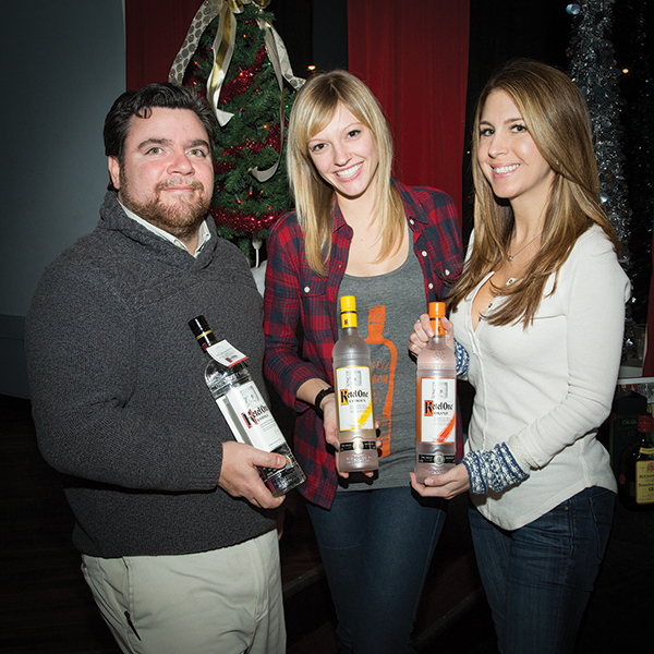 Jared Iannelli, Providence Beverage On Premise Brand Development Manager, Rhode Island Distributing Co.; Tracy Kardeys; and Vanessa Diploma, Events Manager, MKTG Inc. with featured Ketel One products.