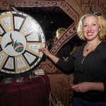 Kirsten Amann, Fratelli-Branca's Fernet Brand Champion spins the wheel on a game used for members to earn their coin.