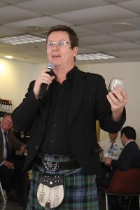Simon Brooking singing a toast.