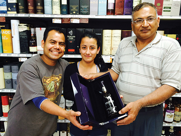 Lucio Marin, Maria Mera and Owner Raj Modi, all of World of Beverages.