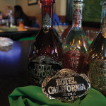 Hotel California Tequila bottles and the grand prize belt buckle. Each bartender had seven minutes to craft a cocktail using Hotel California Tequila.