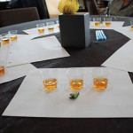 Tasting sample of Bulleit 10, Bulleit Rye, and Bulleit Bourbon Whiskey with a mint leaf.