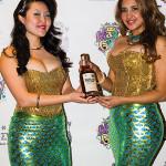 Mermaid models with Sugar Island Rum.