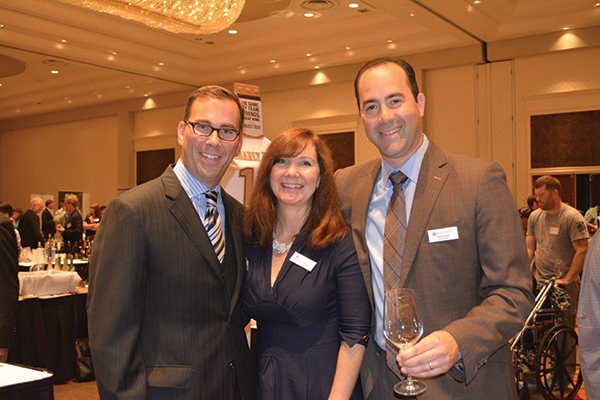 Justin Sullivan, Assistant General Manager; Kathleen Stadler, Marketing Coordinator; Brett Allen, General Manager, all from MS Walker.