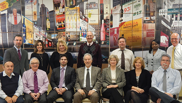 Hartley & Parker's management team, 2015. Back Row: Frank LaTorra, Sales Manager; Carla Sager, Graphic Design Manager; Paula Latham, Accounting Manager; Mike Bylo, Controller; Bill Saroka, Wine Director; Althea Alexander, Credit Manager; and Blaise Tramazzo, Spirit Director. Front Row: Donnie Gallant, Warehouse Manager; Paul Angelico, General Sales Manager; David Rosenberg, Vice President; Jerry Rosenberg, President; Mindy Rosenberg, Assistant to the President; Joyce Halkowicz, Customer Service Supervisor; Gary William, IT Manager. Missing from photo: Pat Oates, Warehouse Manager and Murray Smiling, Night Crew Manager.
