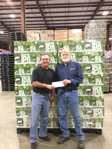 Rhythm & Roots Festival producer Chuck Wentworth receives a $10,000 donation from Terry Moran, President of McLaughlin & Moran. The donation was a matching challenge made by McLaughlin & Moran at the annual Rhythm & Roots Festival sponsored by Goose Island Beer Co.