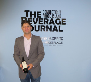 "Michael Munk, Portfolio Manager, CT and RI, Latitude Beverage Co., shown with Magic Door Yountville Cabernet 2013. ""Magic Door provides a rare opportunity for wine lovers to purchase from the world's top producers at a significantly reduced price,"" said Munk."