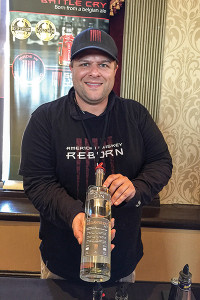 Sons of Liberty Spirits Company Owner Michael Reppucci with True Born Gin.