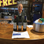 Frank Conklin, Store Associate, Stew Leonard's Norwalk with featured wines, Amethystos and Santorini wines.