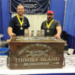 Thimble Island Brewing Company's Alexander Brown, Sales Representative and Dave Morgan, Lead Sales Representative, at the Rhode Island International Craft Beer Festival at the Providence Convention Center, where the brewery received two third place medals for its American Ale and Thimble Lager.