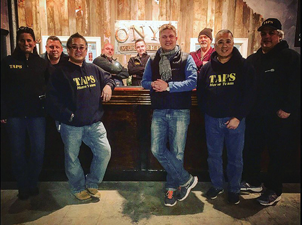 Adam von Gootkin, Co-founder of Onyx Moonshine, seen (in scarf) with the TAPS crew on February 6, 2016. The crew set up equipment in the distillery to test for paranormal activity.