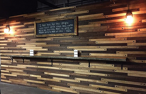 The tasting room features a wall made from oak stave.