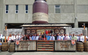 Leigh Ann Lengyel, Regional Sales Manager of Ole Smoky Distillery (center left, first row), kicked off Ole Smoky Moonshine's Lightnin' line with the Hartley & Parker sales force.