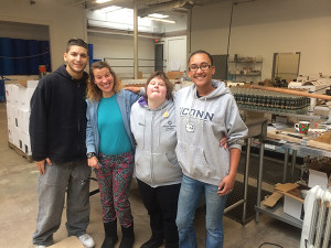 Caleb Davila, Job Coach, MARC, Inc.; Alison Dion, MARC Employee; Allison Cornelius, MARC Employee; and Eryka Wright, Production Manager, Onyx Spirits Company.