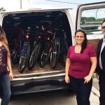 Project Broken Wheel Volunteers delivering bikes to Praise Tabernacle's Live Out Loud Program. Maegan Tikiryan, Alaina Bart and Frank Martucci.