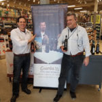 Alex Di Zenzo holding Guardia 33 Aglianco and Ken Roeder holding Guardia 33 Falaghina, both floor managers at Norwalk's Liquor Mart.