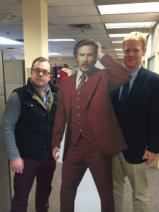 Shown are Slocum & Sons' Key Account/Spirits Manager Alex Meier-Tomkins with a life-sized Ron Burgundy cut-out and Drew Barter, New Haven County Regional Manager.