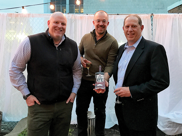 John Slocum, Executive Vice President and General Manager; Alex Meier-Tomkins, Boutique and Craft Brands Director, Slocum & Sons; Tom Schlachtenhaufen, Executive Vice President of Sales, Sagamore Spirit.