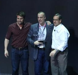 Dichello CEO Sal DiBetta (center) accepts the Anheuser-Busch Ambassador of Excellence Award on March 20, 2015 in Las Vegas.