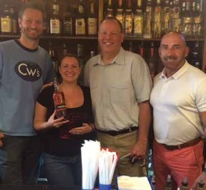 At Corey's Catsup & Mustard in Manchester: Owner Rich Tyrol; Bartender Billie-Jo McCreary; Scott Perrault, Brescome Barton; and David Brogan, Tanduay Key Account Manager.