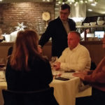 Brian Mitchell, Beverage Director, Max Restaurant Group, pouring wine selections.